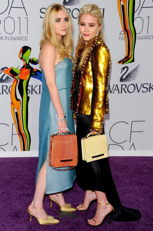 Mary Kate and Ashley Olsen wearing their own designs from The Row