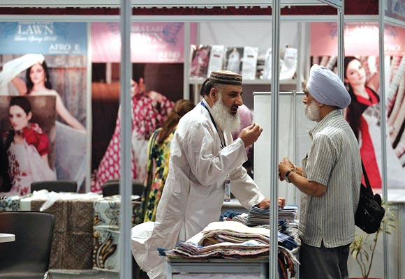 A Pakistan exhibitor (L) speaks with an Indian Sikh visitor at the Lifestyle Pakistan Exhibition in New Delhi April 12, 2012. From gourmet chefs to fashion houses showcasing muslin suits on the catwalk, Pakistan will unveil a trade fair in New Delhi on Thursday to reveal a soft side to traditional foe India as commercial ties between the nuclear-armed rivals begin to bloom.