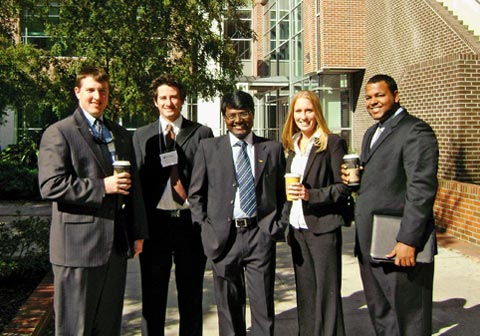 Surya (middle) with classmates at University of Florida