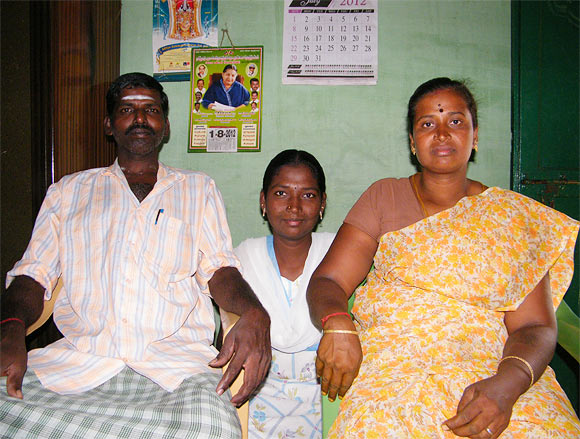 Menaka Murugan with her parents