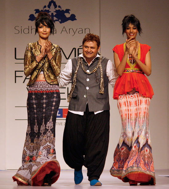 Sidharta Aryan with two of his designs