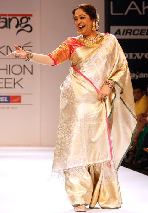 Kirron Kher looks like she's having the time of her life as she steps out in a lovely champagne-hued drape.