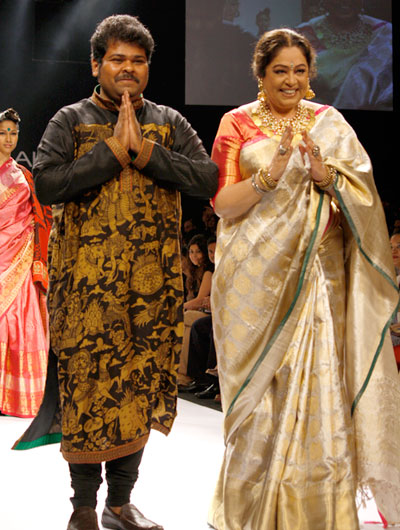More									 				 				 				 			 						 			 			The designer's kurta mirrors his theme; he acknowledges the applause alongside his venerable muse.