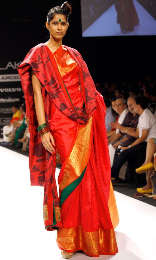 A Kanjeevaram border and kalamkari shawl work well together in vivacious red.