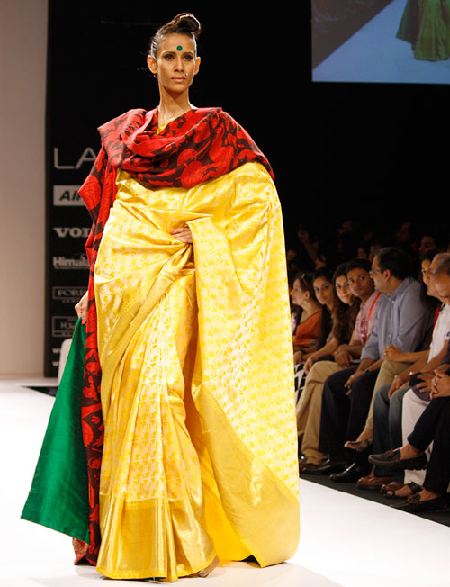 Kavita Kharayat is a vision in bright yellow, channelling old-world glamour.