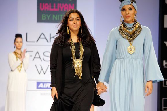 Nitya Arora takes to the runway, accompanied by model Deepti Gujral.