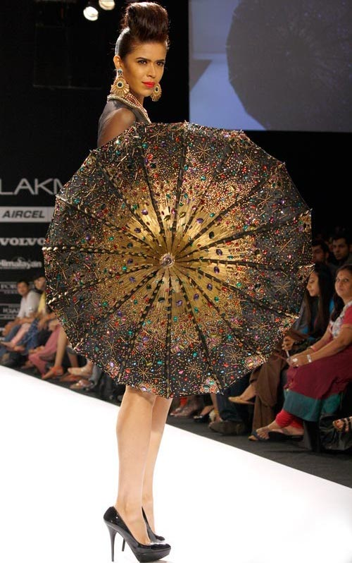 The designers give free reign to their imagination with this stunning studded umbrella, carried by Sucheta Sharma.
