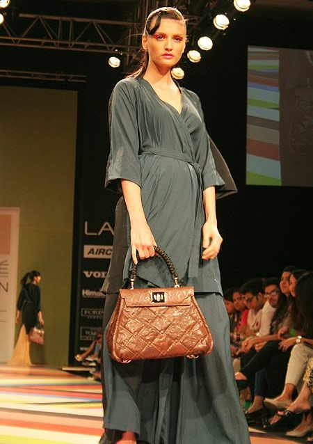 Next we see a quilted brown purse with touches of black -- the ideal neutral carry-all.