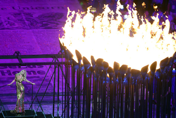 Model Kate Moss poses in front of the Olympic Cauldron during the Closing Ceremony at the London 2012 Olympic Games at the Olympic Stadium on August 12, 2012 in London, England