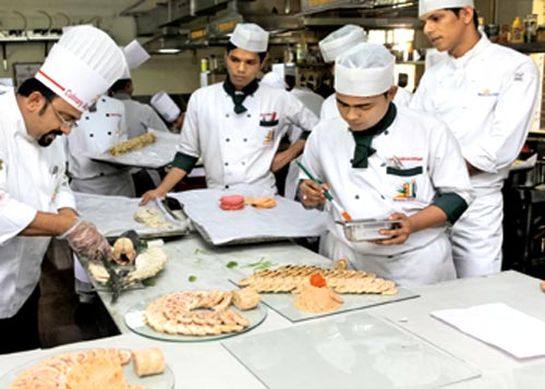 Chef Sudhakar (left) trains aspiring chefs at Culinary Academy of India, Hyderabad