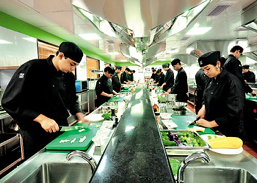 Students training at their individual places, called work stations, in the institute kitchen