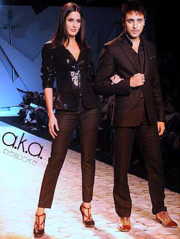 Actors Katrina Kaif and Imran Khan sport their shoe creations at the Van Heusen India Men's Week 2011