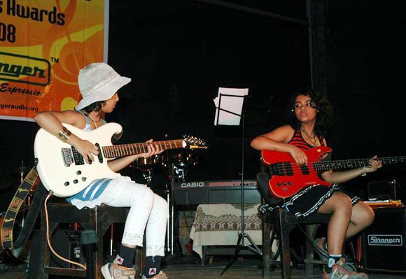 Esani Dey (left), now 13, performs with elder sister Mohini Dey (right)