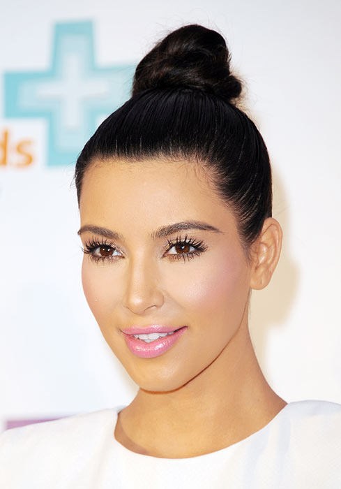 Kim Kardashian is often seen sporting a neat coiled bun