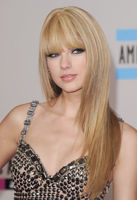 Curly-haired Taylor Swift likes a change on the red carpet now and then with a poker-straight do