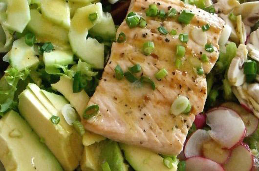 Opt for healthy protein choices for lunch, like a salmon avocado salad