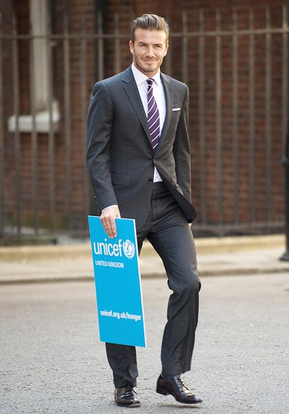 The ever-so-stylish David Beckham arrives to meet British Prime Minister David Cameron, in Downing Street