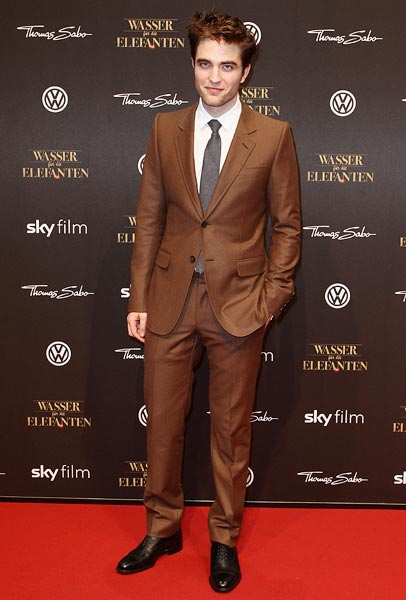 Robert Pattinson in a brown Gucci suit at the Wasser fuer die Elefanten (Water For Elephants) premiere in Berlin, Germany