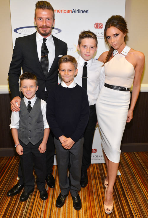 David ands Victoria Beckham with sons (L-R) Cruz, Romeo and Brooklyn; they are also parents to baby daughter Harper Seven (not pictured)