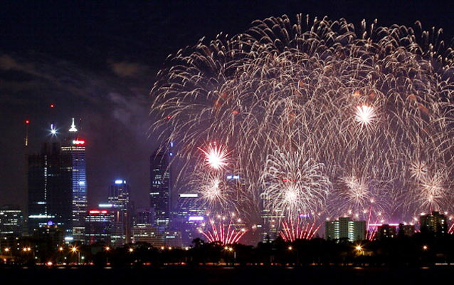 Fireworks are pictured with the Perth city skyline as Australia celebrates Australia Day