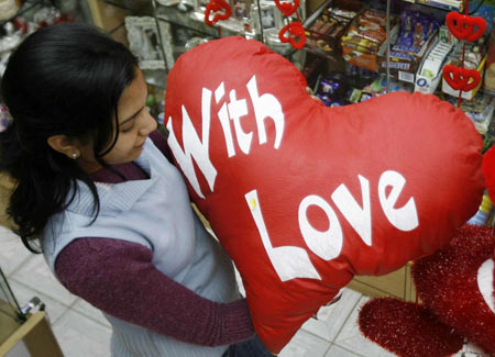 A girl looks for gifts at a shop ahead of Valentine's Day celebrations in the northeastern Indian city of Siliguri February 12, 2008. Valentine's Day, which is celebrated around the world on February 14, is a relatively new western celebration in India, which has been slammed by some hardliner Hindus for eroding traditional Indian culture.