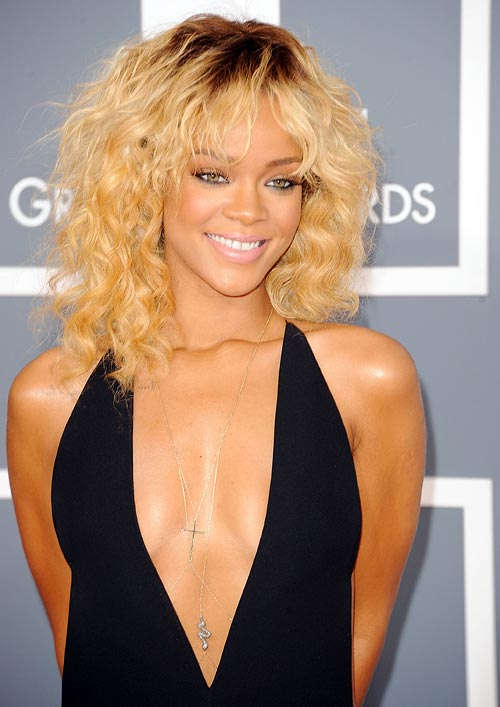 For curly and dry hair like popstar Rihanna here, choose a good shampoo and conditioner
