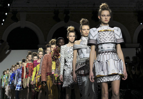 Models walk the ramp for Mary Katrantzou during London Fashion Week