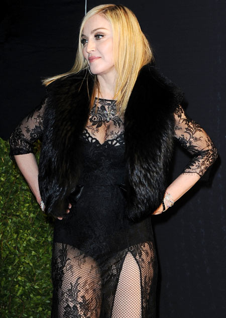 Madonna is unruffled about appearing half-dressed at an A-list party