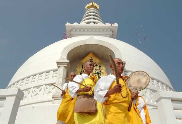 Japanese Buddhist monks offer prayers at Viswa Shanti Stupa or world Peace Pagoda to celebrate its 35th anniversary in Rajgir, 105 Km (65 miles) southeast of the eastern Indian city of Patna October 25, 2004. Hundreds of monks mainly from Japan offered prayer ceremony to mark the 35th anniversary of peace pagoda in Rajgir on Monday.