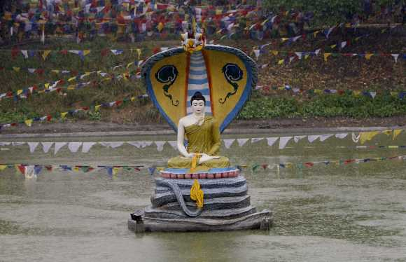 An idol of Lord Buddha is seen at the Mahabodhi temple compound, in the eastern Indian city of Bodh Gaya January 23, 2008. Tales of corruption, looting and religious rivalry are swirling around the spot where Buddha is said to have gained enlightenment in eastern India some 2,500 years ago, sullying one of Buddhism's holiest sites. Picture taken January 23, 2008.