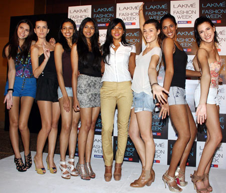 Supermodel Nina Manuel (fifth from left) poses with winners of the Lakme Summer 2012 auditions