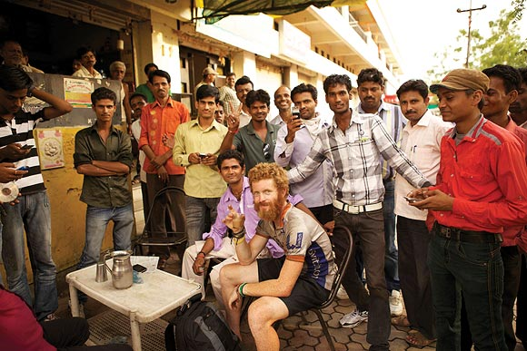 Sean Conway takes a break at a tea stall in Amravati, India