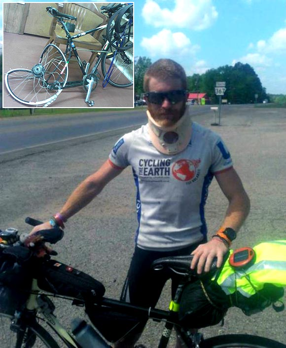 Sean Conway was back on the road four days after the accident; (inset) his bike after he was thrown by a truck
