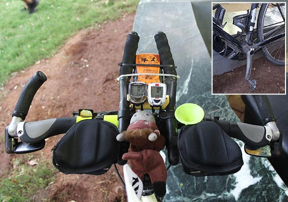 Sean Conway's assembled bike has a GPS map navigator and a GPS transmitter, while its pedals (inset) are engineered to fit his shoes