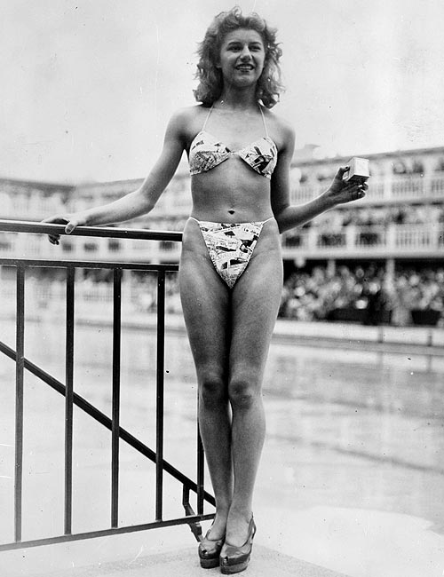 Micheline Bernardini modelling Louis Reard's bikini on July 5, 1946; she is seen holding a small box into which the entire costume can be packed