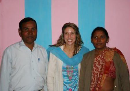 Manoj's  occupational therapist (centre) flanked by his parents