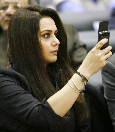 Bollywood actress Preity Zinta takes pictures with her mobile phone during the Vibrant Gujarat Global Investors' Summit 2011 (VGGIS) at Gandhinagar in the western Indian state of Gujarat January 12, 2011.