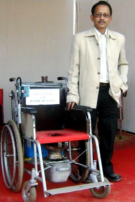 Bharali with his mechanised toilet for the handicapped