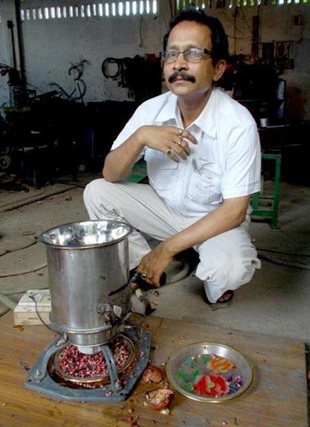 Bharali with his pomegranate de-seeder, which has been nominated for an award by NASA
