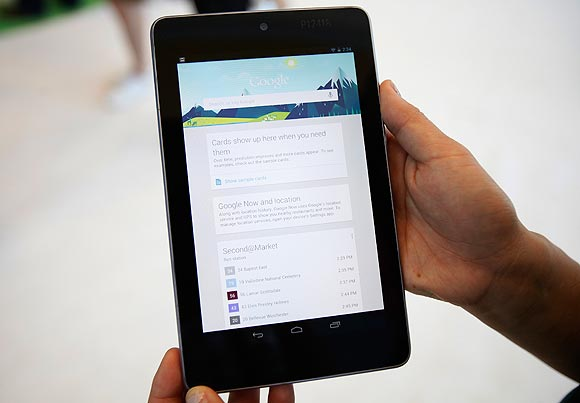 An attendee uses a Google Nexus 7 tablet during Google I/O 2012 Conference at Moscone Center in San Francisco, California June 27, 2012.