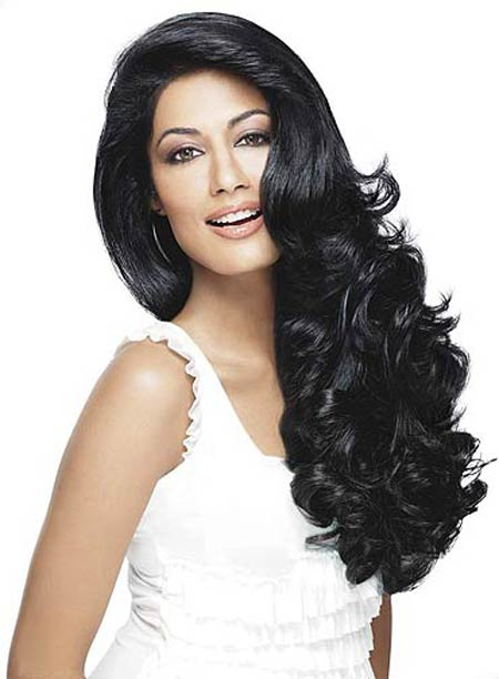 Tame your locks with smoothing products for this glamorous effect, seen on Chitrangada Singh