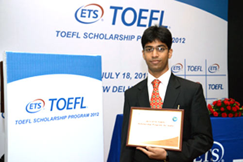 Darshan Shah receives a certificate of excellence for cracking TOEFL scholarship 2012.