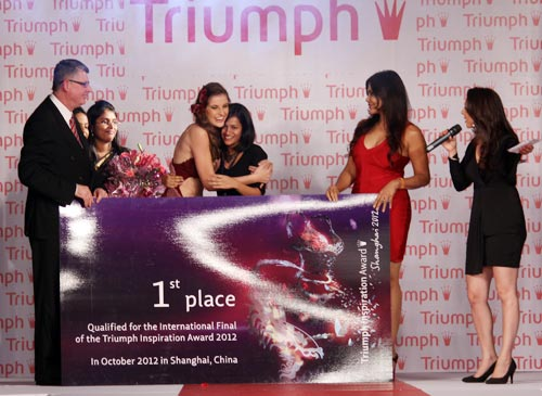 Pooja (third from right) is presented with her award at the Triumph Inspiration Awards in Mumbai, May 2