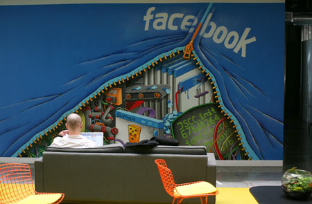 An employee works on a computer at the new headquarters of Facebook in Menlo Park, California January 11, 2012. The 57-acre campus, which formerly housed Sun Microsystems, features open work spaces for nearly 2,000 employees on the one million square foot campus, with room for expansion. Picture taken January 11, 2012.