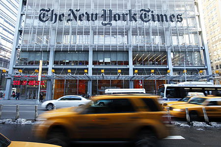 Vehicles drive past the New York Times headquarters in New York.