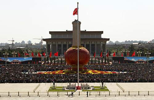 Tourists gather around a giant red lantern on display at Beijing's Tiananmen Square