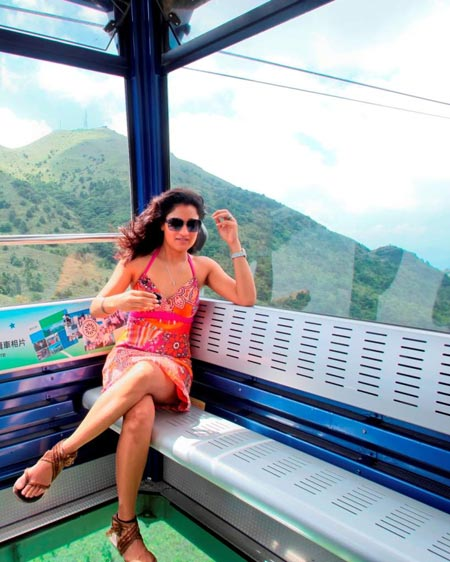 Sandhya taking a cable car ride