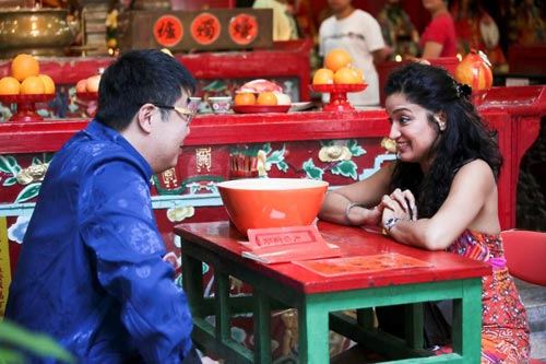 Sandhya with a fortune-teller at a traditional Tin Hau temple