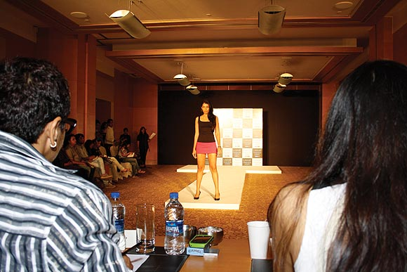 A model poses while judges Anjana Sharma (left) and Purnima Lamba (right) look on