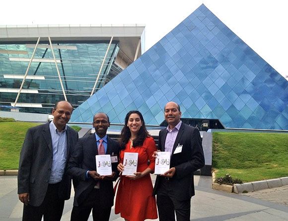 The authors with Vijay Anand, MD Intuit India, at the Infosys Bangalore campus
